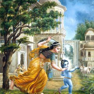 Mother Yashoda is running after child Krishna with a small stick.
