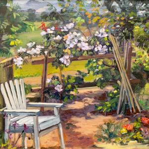A white wooden garden chair is represented in front of a trellis full of flowers
