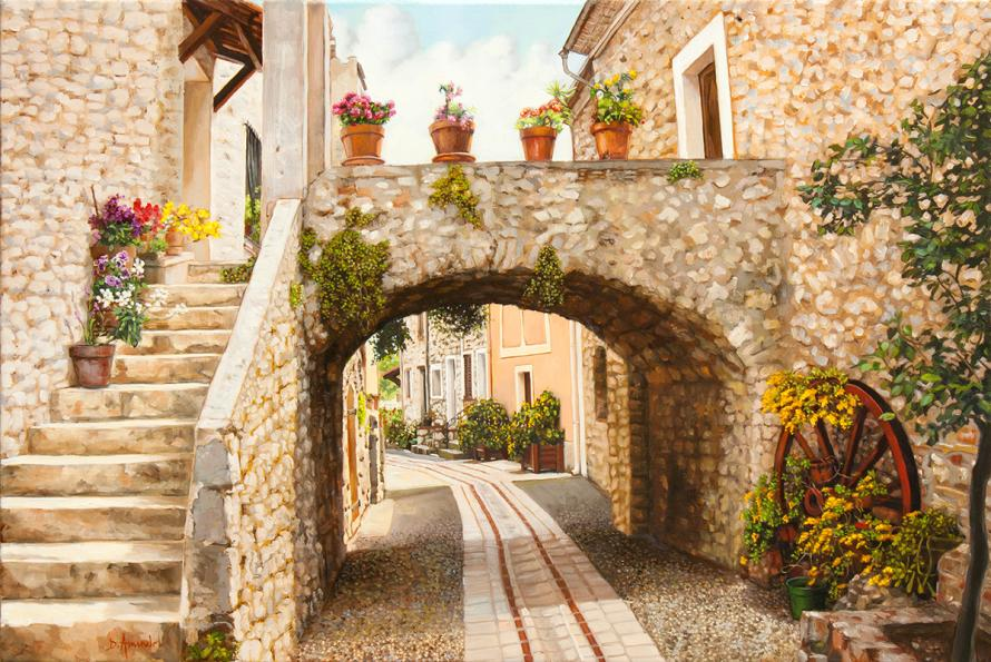 A traditional street entirely paved in warm coloured stones, everywhere.