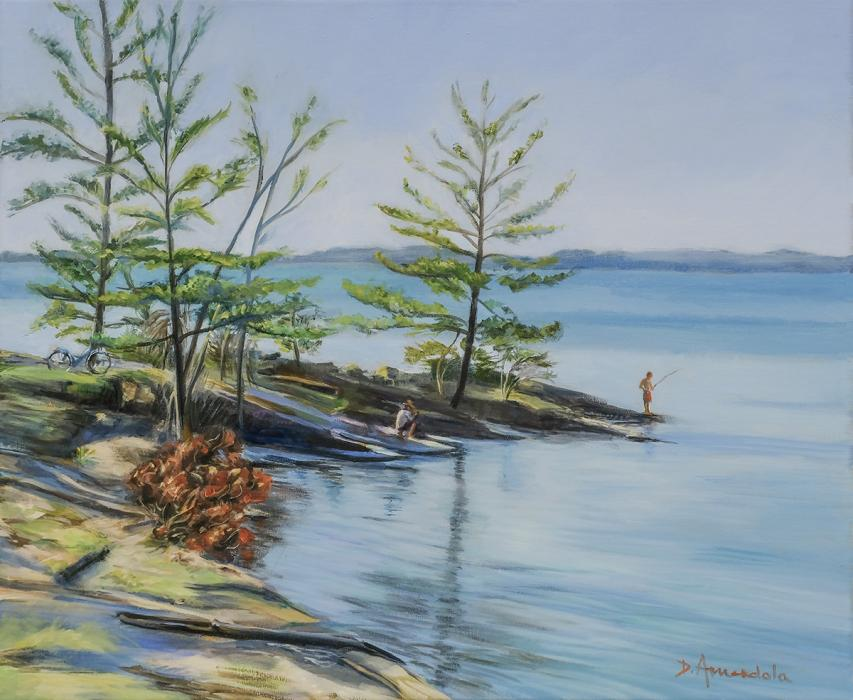 view of the lake, with trees on the shore, prominent rocks, and a couple figures